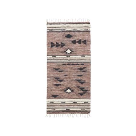 Tribe van House Doctor is een stoer vloerkleed met een mooi grafisch patroon in lichte en donkere tinten.