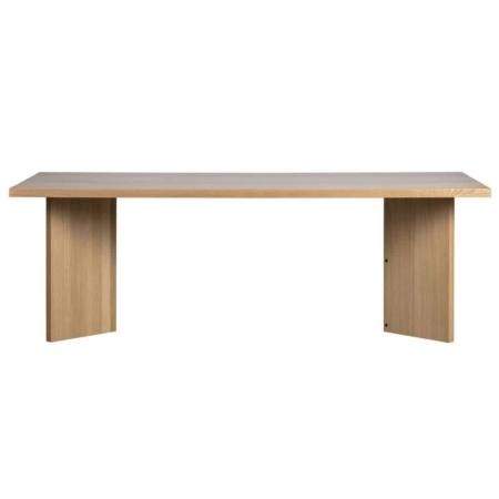 Angle is een eigentijdse eettafel met een originele poot uit de collectie van het Nederlandse merk vtwonen. De eettafel is vervaardigd uit eiken fineer met een naturel kleurige finish. De poot heeft een originele vorm, dit geeft een verrassend effect aan de eethoek. De tafel is afgewerkt met een matte blanke lak om het hout te beschermen tegen vlekken. Het tafelblad van Angle heeft een dikte van 4 cm. De ruimte tussen de tafelpoten is 130 cm. De hoogte van de onderkant tafelblad tot de grond is 71 cm, houdt hier rekening mee wanneer je een eetkamerstoel met armleuningen plaatst.