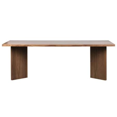 Angle is een eigentijdse eettafel met een originele poot uit de collectie van het Nederlandse merk vtwonen. De eettafel is vervaardigd uit notenhout fineer met een warme, bruine finish. De poot heeft een originele vorm, dit geeft een verrassend effect aan de eethoek. De tafel is afgewerkt met een matte blanke lak om het hout te beschermen tegen vlekken. Het tafelblad van Angle heeft een dikte van 4 cm. De ruimte tussen de tafelpoten is 130 cm. De hoogte van de onderkant tafelblad tot de grond is 71 cm, houdt hier rekening mee wanneer je een eetkamerstoel met armleuningen plaatst.