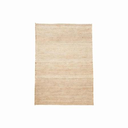 Versier het huis met mooie tapijten om een kamer te creëren die van comfort ademt.